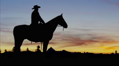 Silhouette of Cowboy Rider Ranch wilderness area Canada - stock footage