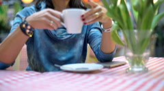 Woman drinking coffee and smiling to the camera, steadycam shot Stock Footage