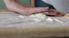 Chef grind flour on the table - stock footage