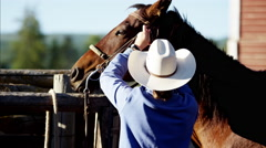 Cowgirl in corral with his horse Dude Ranch Canada Stock Footage