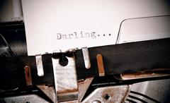 Darling word typed on old black typwriter - stock photo