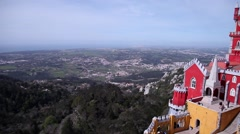 Pena Palace in Sintra Portugal on windy day  pan view Stock Footage