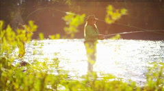 St Mary River female and male Freshwater fly fishing Canada Stock Footage