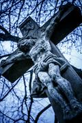 old cross with jesus christ from stone - christianity - stock photo