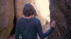 Petite Young Attractive Female Dreamily Walks Through Rock Forest Slow Motion - stock footage