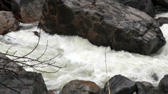 Merced River Flowing Rapidly Between Rocks Yosemite California - stock footage