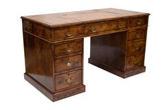 An Old Solid Wood Pedestal Desk - stock photo