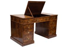 An Antique Wooden Pedestal Desk with Compartment Top - stock photo