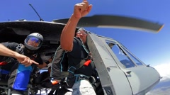 Skydiving, jump from helicopter Bell Huey, exit 6000 feet. Stock Footage