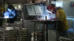 Steel welding operators working, slider shot Stock Footage