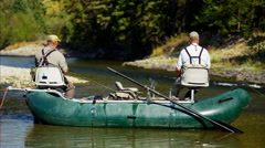 People in the Wilderness freshwater fly fishing from dingy Stock Footage