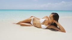 Beach body woman sunbathing sexy on vacation - Sexy babe in bikini - stock footage