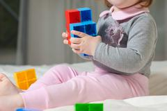 Cute baby playing Stock Photos