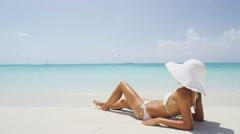 Sexy beach bikini body woman relaxing sun tanning - stock footage