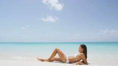 Suntan woman getting a bikini sun tan on beach vacation travel Stock Footage