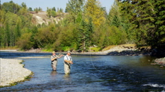 Rod and reel fisherman casting line in freshwater river Canada Stock Footage
