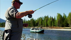 St Mary River fisherman Freshwater fly fishing Canada Stock Footage