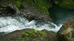 Clear waterfall cascading into pool, from above, Karamatura Falls, New Zealand. Stock Footage