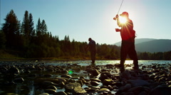 Skilled hobby fisherman in silhouette casting line for freshwater fishing Stock Footage