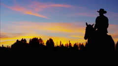 Silhouette sunset of Cowboy Rider forest wilderness Canada Stock Footage