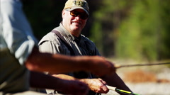 River dingy fly fishing males on freshwater river Wilderness area Stock Footage