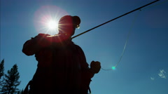 Silhouette of skilled hobby freshwater fisherman casting fishing line Canada - stock footage