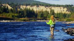 Skilled hobby female casting line freshwater fishing USA - stock footage