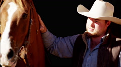 Portrait of a cowboy with his horse on Dude Ranch in Corral USA Stock Footage
