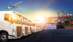 Container truck ,ship in port and freight cargo plane in transport and import Stock Photos