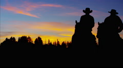 Silhouette of Cowboy Riders forest wilderness area Canada Stock Footage