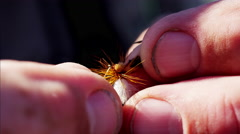 Dry fly bait handmade by skilled freshwater fisherman - stock footage