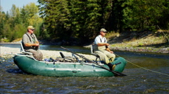 Males fly fishing from rib boat St Mary River Canada BC - stock footage