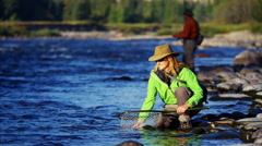Portrait of Cutthroat Trout caught by skilled female while fishing in Canada - stock footage