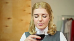 Woman sommelier tasting and evaluating red wine. Female drinking alcohol - stock footage