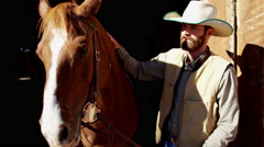 Stock Video Footage of Portrait of a cowboy ranch hand bonding with horse on Dude Ranch Canada
