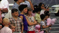 1967: Crowd of kids watch circus performance eating cotton candy. Stock Footage