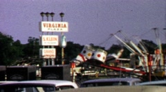 1967: Virginia Plaza hosts traveling carnival circus amusement rides. Stock Footage