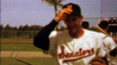 1960: Washington Senators baseball player tips hat to fan photographer. Stock Footage