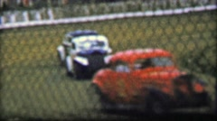 1957: Classic car stock racing track behind flimsy safety fence. Stock Footage