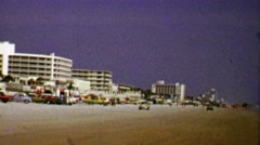 1967: Hotels on spring beach party beach vacation begins. Stock Footage