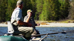 People in the Wilderness freshwater fly fishing from dingy USA Stock Footage