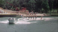 1967: Waterskiing performer pyramid USA Dutch flags flying. Stock Footage