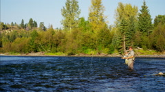 Canadian males fly fishing in competition on freshwater river Stock Footage