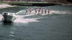 1967: Pick playboy bunny women waterskiing tandem show. Stock Footage