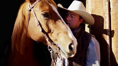 Cowboy Ranch hand with horse on Dude Ranch in Corral USA - stock footage