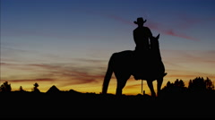 Silhouette of Cowboy Rider Ranch wilderness area Canada Stock Footage