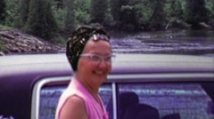 1961: Happy woman waiting by car after river fishing trip. Stock Footage