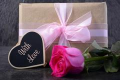 Mothers Day gift with pink rose. - stock photo