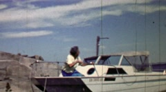 1957: Women awaits leisure boating sitting on boat front. Stock Footage