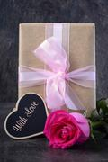 Mothers Day gift with pink rose. Stock Photos
